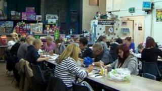 People sitting inside a church hall