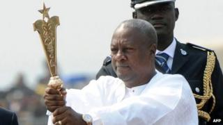 Ghanaian President John Mahama raises the staff of office after swearing to an oath of office at the Independence Square, Accra in January 7. 2013.