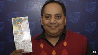 This undated photo provided by the Illinois Lottery shows Urooj Khan posing with a winning lottery ticket
