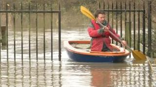 Paul Otter in rowing boat during floods