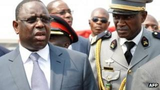 Senegalese President Macky Sall (L) arrives at the inauguration of Ghanaian President John Mahama on 7 January 2013