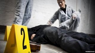 Crime scene technicians investigate a body