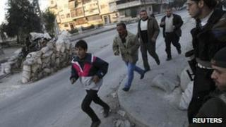 Residents run for cover in Aleppo