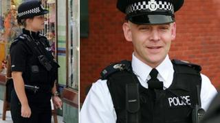 Officers in black zip-up polo shirt (left) and new white collar and tie