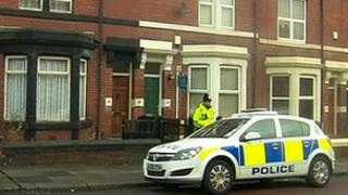 Police car outside house in Biddlestone Road, Heaton