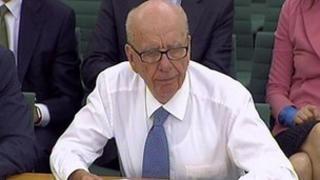 Rupert Murdoch addressing a parliamentary select committee