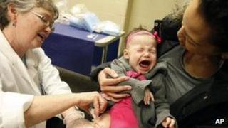 A baby receives a flu vaccine 11 January 2012