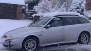 Car skidding on snow and ice