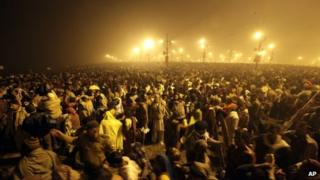 Thousands of Hindu devotees gather at Sangam, the confluence of the Ganges, Yamuna and mythical Saraswati river on Makar Sankranti, the first day of the Maha Kumbh Mela, in Allahabad, early Monday morning, Jan. 14, 2013.