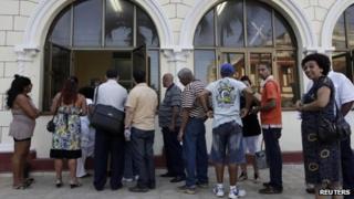 People queue up for passports in Havana