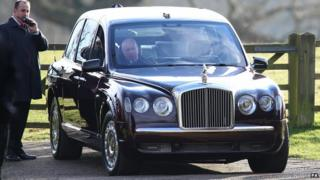 The Queen's driver tries to start her Bentley after it failed to start first time at Mary Magdalene Church