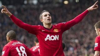Robin van Persie celebrates after scoring against Liverpool