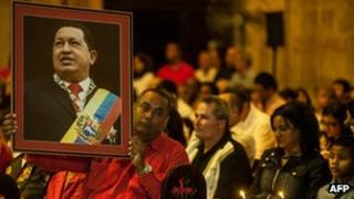 People attend a Catholic mass for the health of Venezuelan President Hugo Chavez in Havana on 12 January 2013