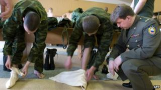 Army conscripts using foot cloths - file pic