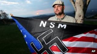Jeff Hall, who was killed by his son, holds a Neo Nazi flag while standing at Sycamore Highlands Park near his home in Riverside, California October 2010