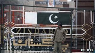 A paramilitary soldier stands guard beside a border gate at the India-Pakistan joint checkpoint at the Wagah border near Lahore 6 January 2013