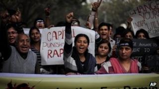 Protestors shout slogans while demanding capital punishment for rapists in Delhi.