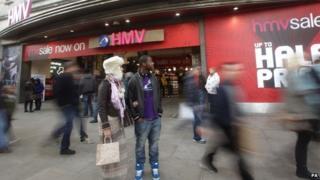 Shoppers outside HMV