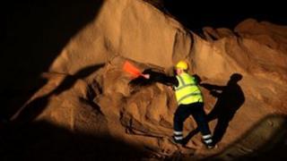 A man shovelling rock salt