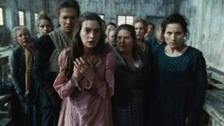 Anne Hathaway (centre) with others in a scene from Les Miserables