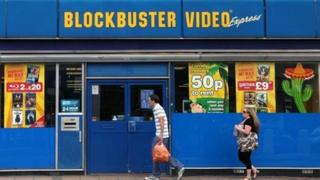People walk past Blockbusters store (file photo 2010)