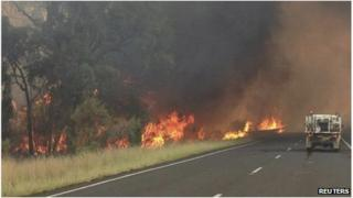 The Redbank North Fire burns alongside the Newell Highway near Coonabarabran, NSW Australia (16 Jan 2013)