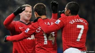 Wayne Rooney celebrates with teammates