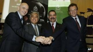 From left to right: Uefa Secretary General Gianni Infantino, Italian Police Deputy Chief Francesco Cirillo, Interpol Secretary General Ronald Noble and Fifa Secretary General Jerome Valcke shake hands in Rome