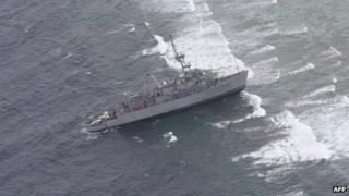 Image released on 18 January 2013 by Philippine Western Command (WESCOM) shows USS Guardian aground on Tubattaha reef in western Philippines island of Palawan