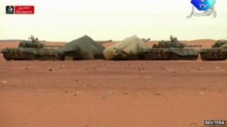 TV image of tanks near the scene of the siege in Algeria on 17/1/13