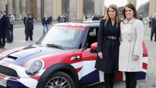 The princesses stood next to their Mini which is decorated in Union flag livery