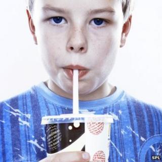 A boy drinking a fizzy drink