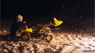 Child with digger in snow