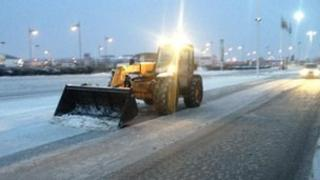 Tractor clearing snow outside Pride Park