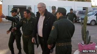 Algerian gendarmes escort former Norwegian hostage at In Amenas - 19 January