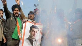 Congress party members set off firecrackers as they celebrate the appointment of Rahul Gandhi as Congress party Vice-President, in Amritsar on January 20, 2013.