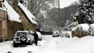 Woman tries to get her vehicle ready for the snow in Rutland