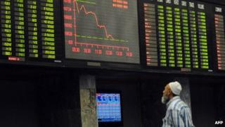 A Pakistani stockbroker watches share prices at the Karachi Stock Exchange (January 2013)