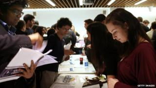 Job seekers speak with company recruiters at the New York City Start-up Job Fair