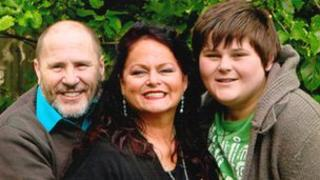 Angela Davies with her husband and son