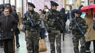 "French soldiers patrol on the Champs Elysees avenue in Paris as part of the ""Vigipirate"" heightened security plan"