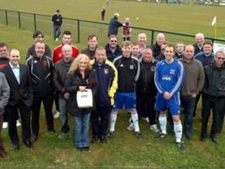 Paula Lunt presents the FA with their defibrillators