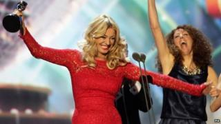 Tess Daly accepts the award for Best Talent Show for Strictly Come Dancing during the 2013 National Television Awards