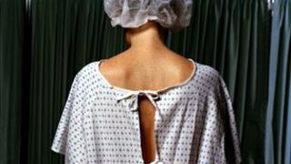 Patient wears a hospital gown