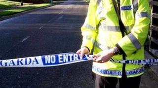 Irish police officer sealing off crime scene