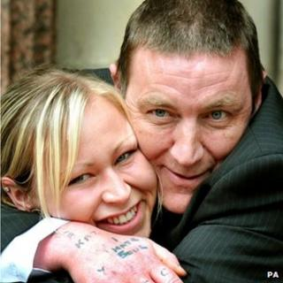 Ian Lawless cuddling his daughter Laura Jayne Lawless outside the High Court in central London in 2009