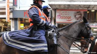 Mounted police in the Matonge district in Brussels, in December 2011, after the re-election of Joseph Kabila as DRC president