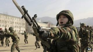 Woman soldier in South Korea, which allows female artillery officers and fighter pilots