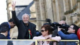 MP George Galloway of the Respect party, waves to supporters during an open top bus tour in Bradford, following his victory in last nights Bradford West by-election