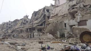 Damaged buildings in Homs (25 January 2013)
